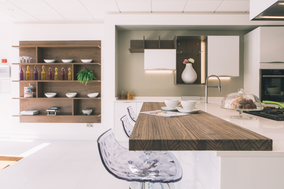 Open Plan Kitchen Breakfast Bar. Our high gloss White Vitus display shows how a breakfast bar can be used  not only to transition between kitchen and living area but expand on the Spotlight On Open plan